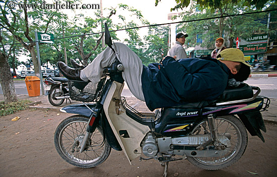 man-sleeping-on-motorcycle-big